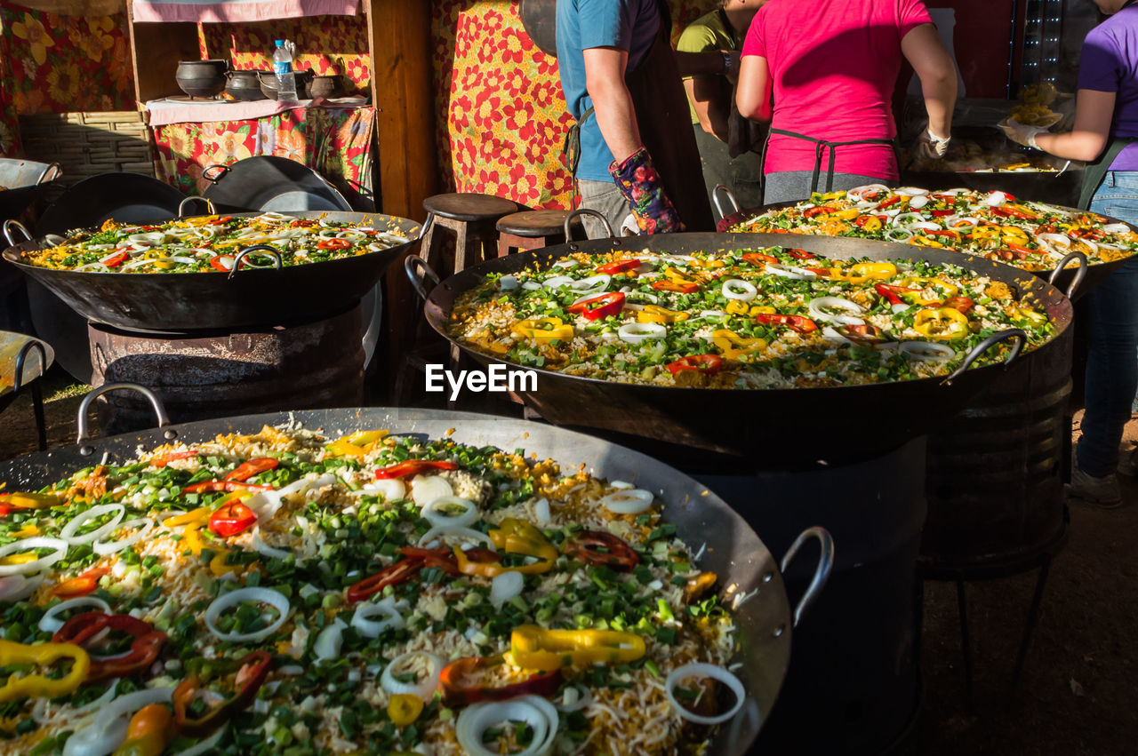 food, food and drink, real people, freshness, midsection, men, women, outdoors, day, close-up, ready-to-eat, people