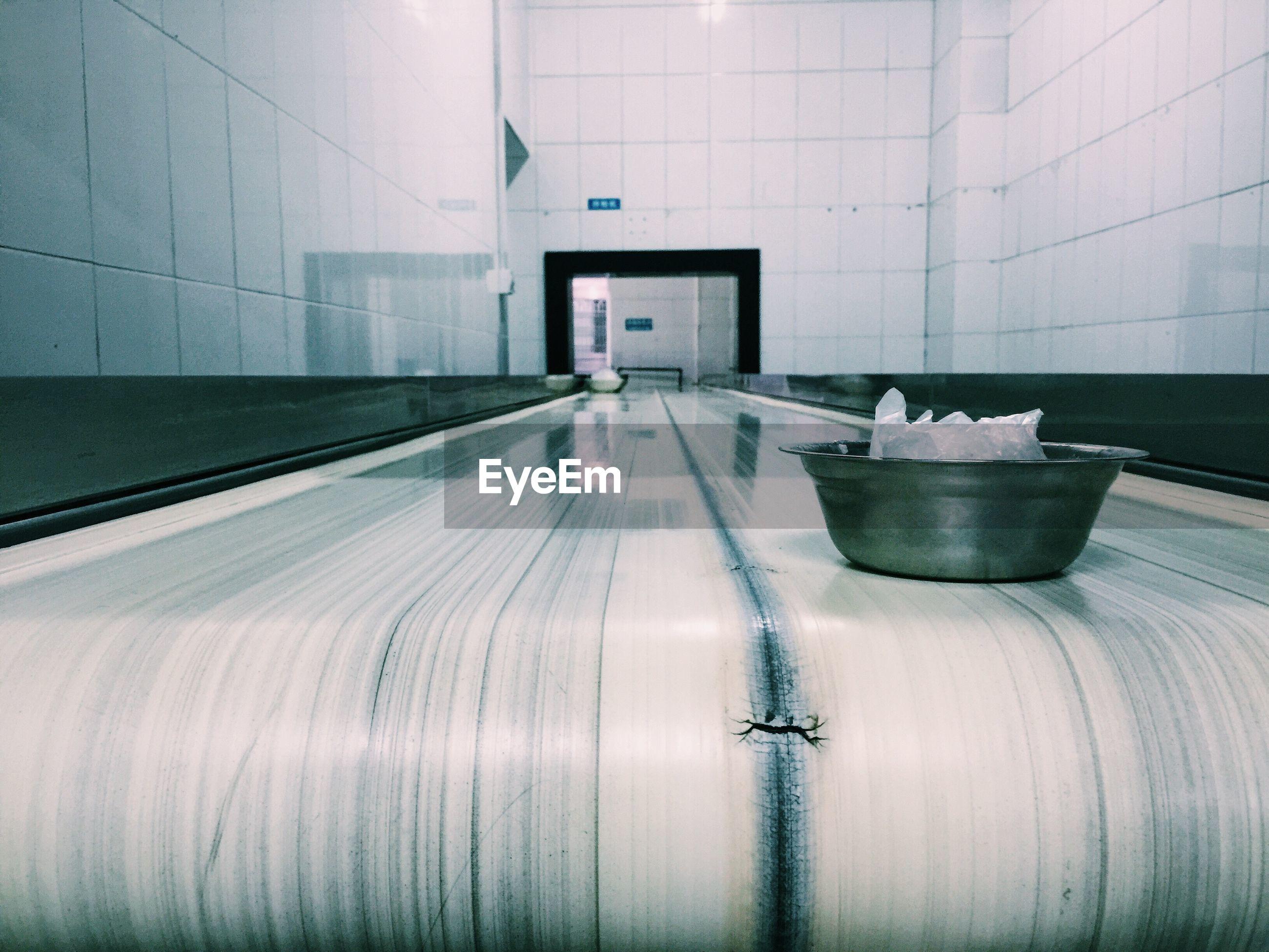 Bowl on conveyor belt in factory