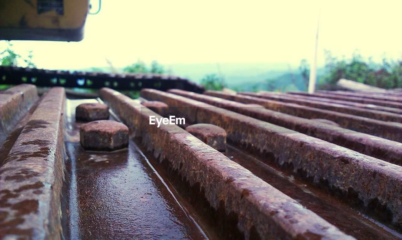 focus on foreground, no people, metal, rusty, day, outdoors, close-up, industry, nature, sky