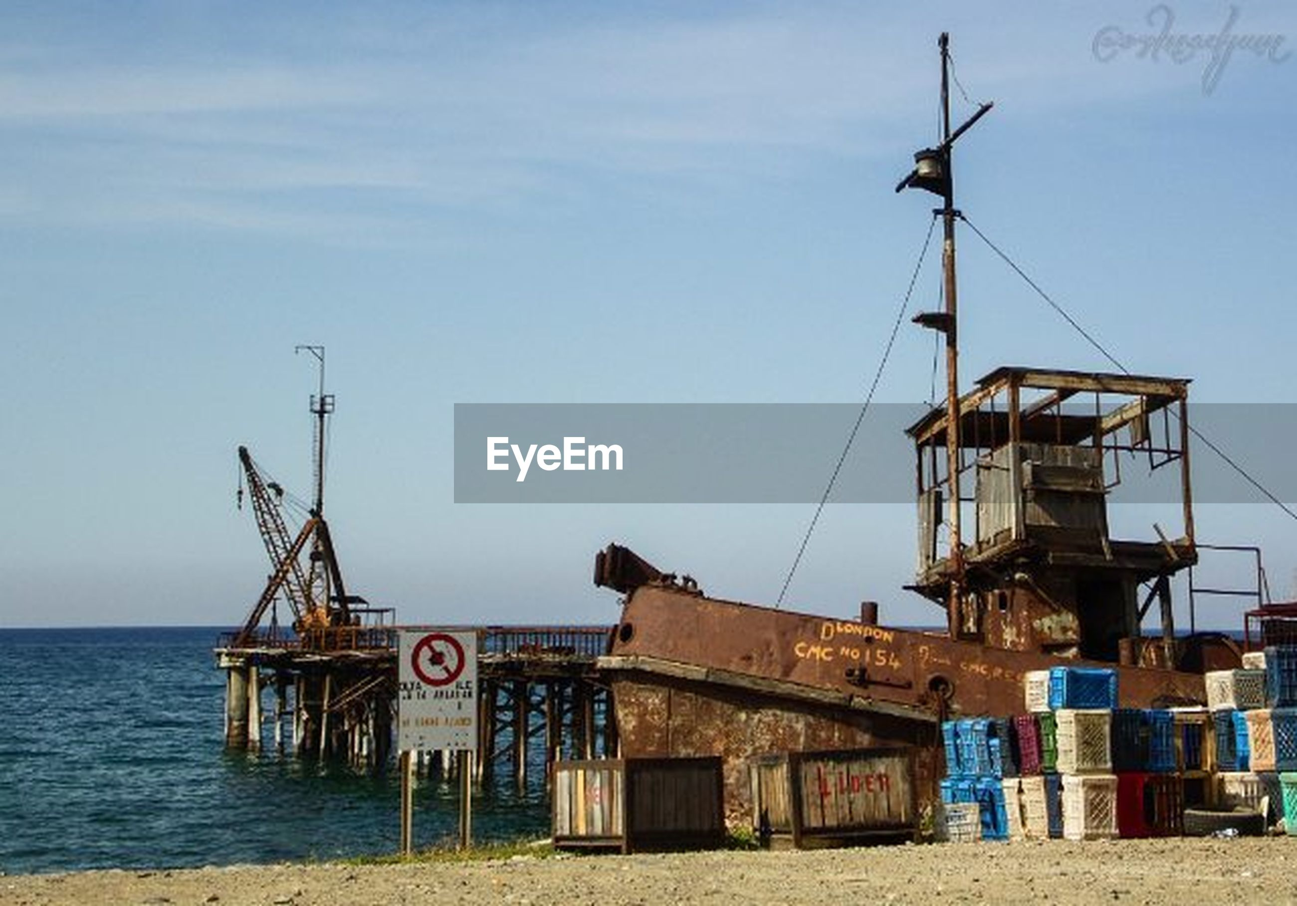 water, sea, sky, built structure, nautical vessel, architecture, building exterior, beach, environmental conservation, fuel and power generation, day, alternative energy, commercial dock, windmill, clear sky, outdoors, nature, moored, horizon over water, wind power