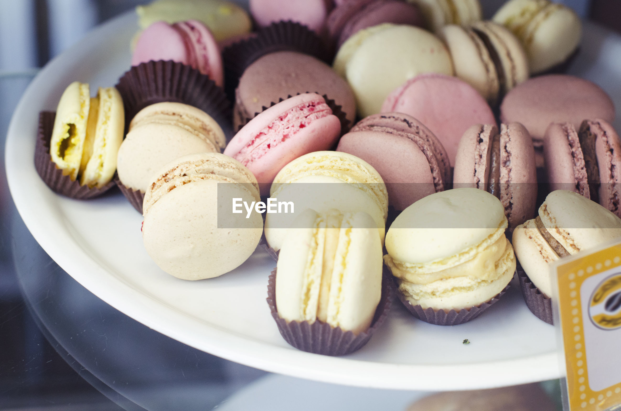 Close-up of macaroons in plate at store for sale