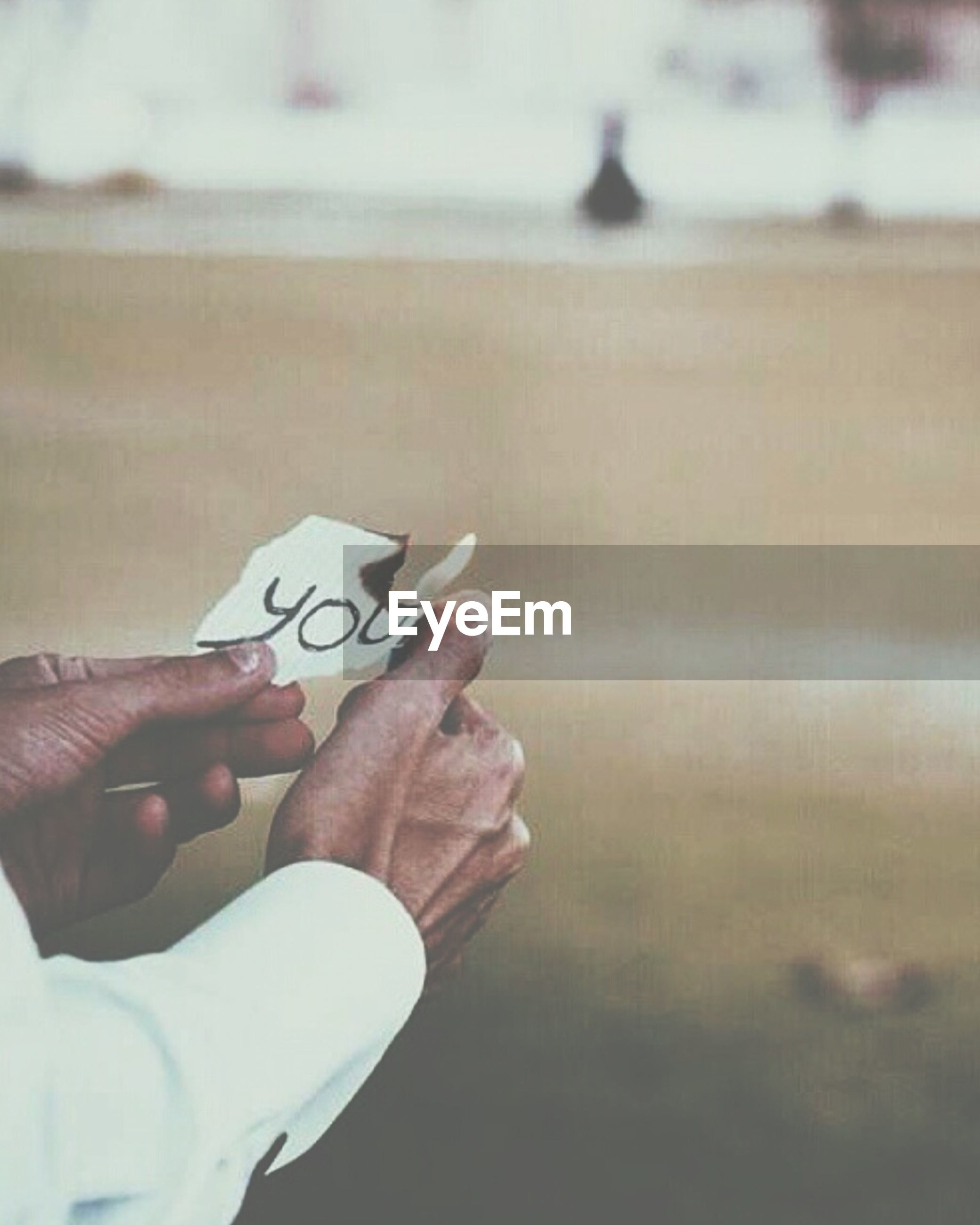 person, part of, holding, human finger, cropped, focus on foreground, unrecognizable person, close-up, lifestyles, leisure activity, personal perspective, text, communication, men, selective focus, indoors, western script