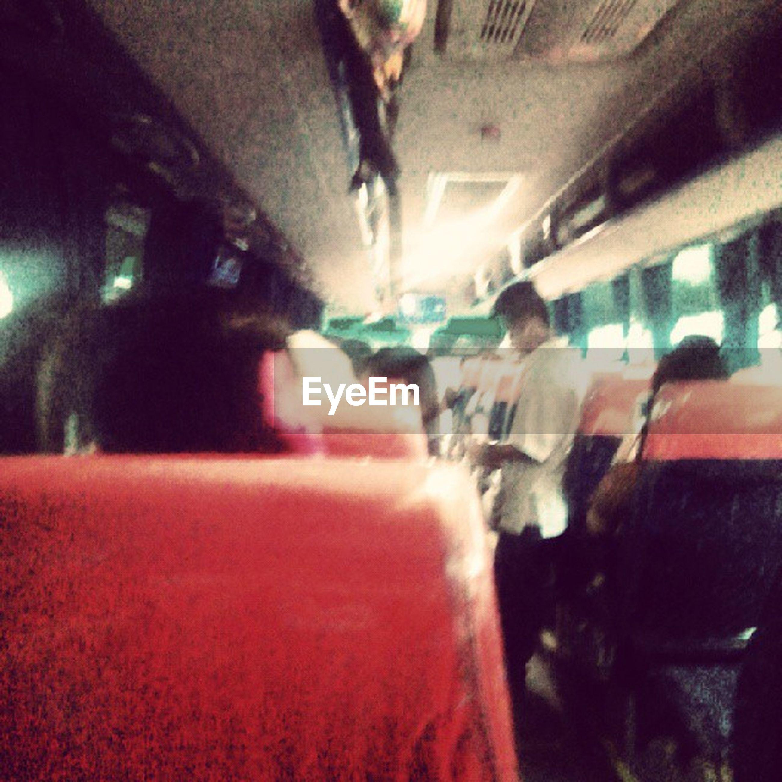 transportation, mode of transport, land vehicle, car, lifestyles, men, vehicle interior, travel, illuminated, incidental people, blurred motion, leisure activity, person, city life, street, on the move, night, public transportation