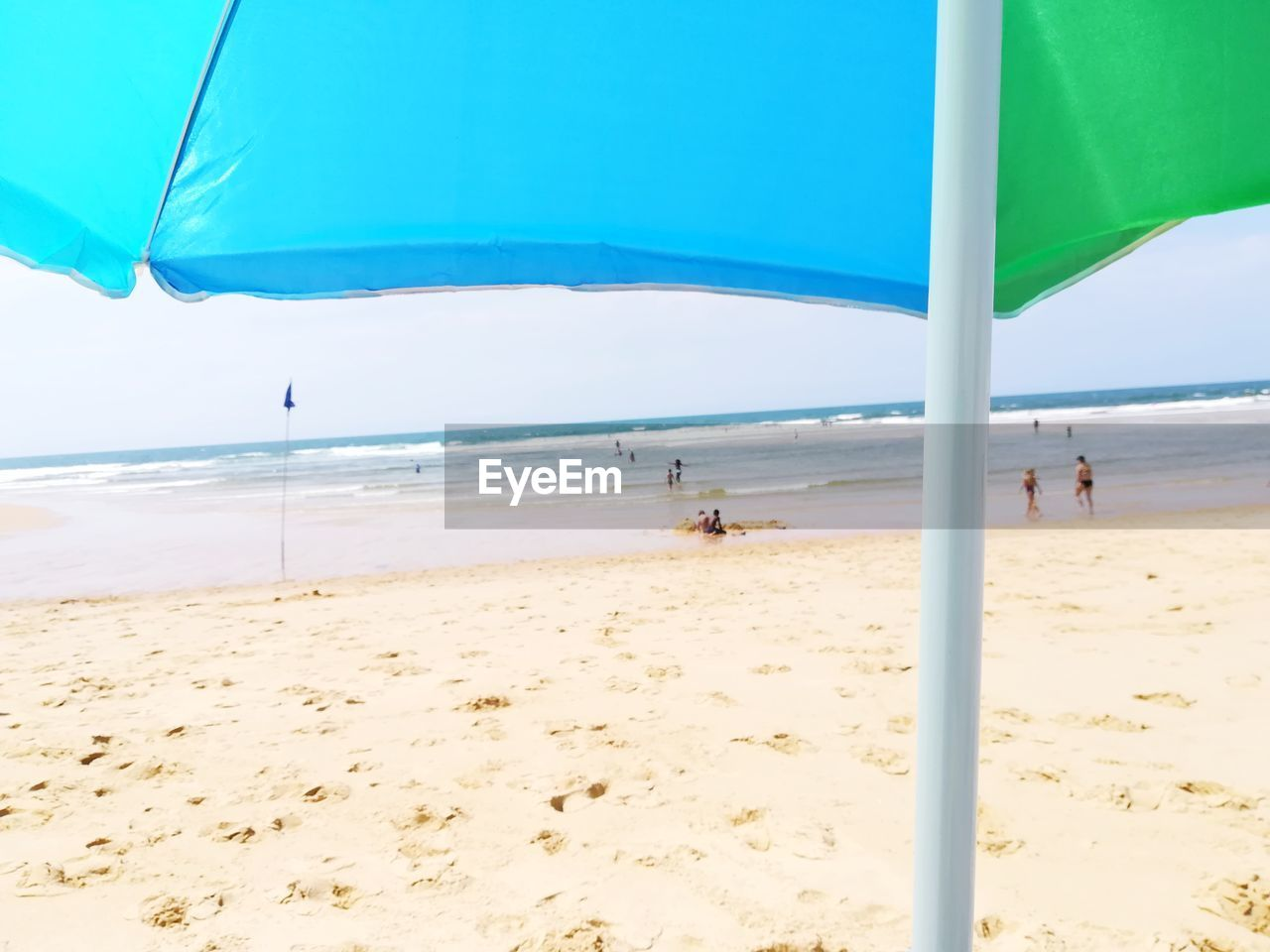 beach, land, sea, water, sand, sky, day, nature, incidental people, horizon, horizon over water, vacations, summer, trip, sunlight, holiday, scenics - nature, parasol, beauty in nature, outdoors, wind