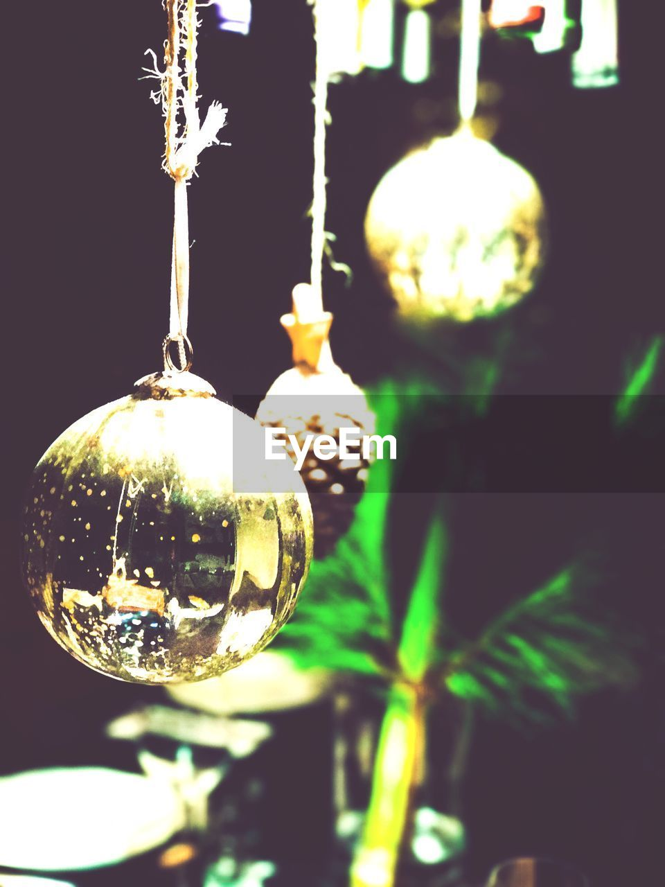 hanging, no people, focus on foreground, close-up, night, illuminated, christmas ornament, tree, outdoors, christmas decoration, nature