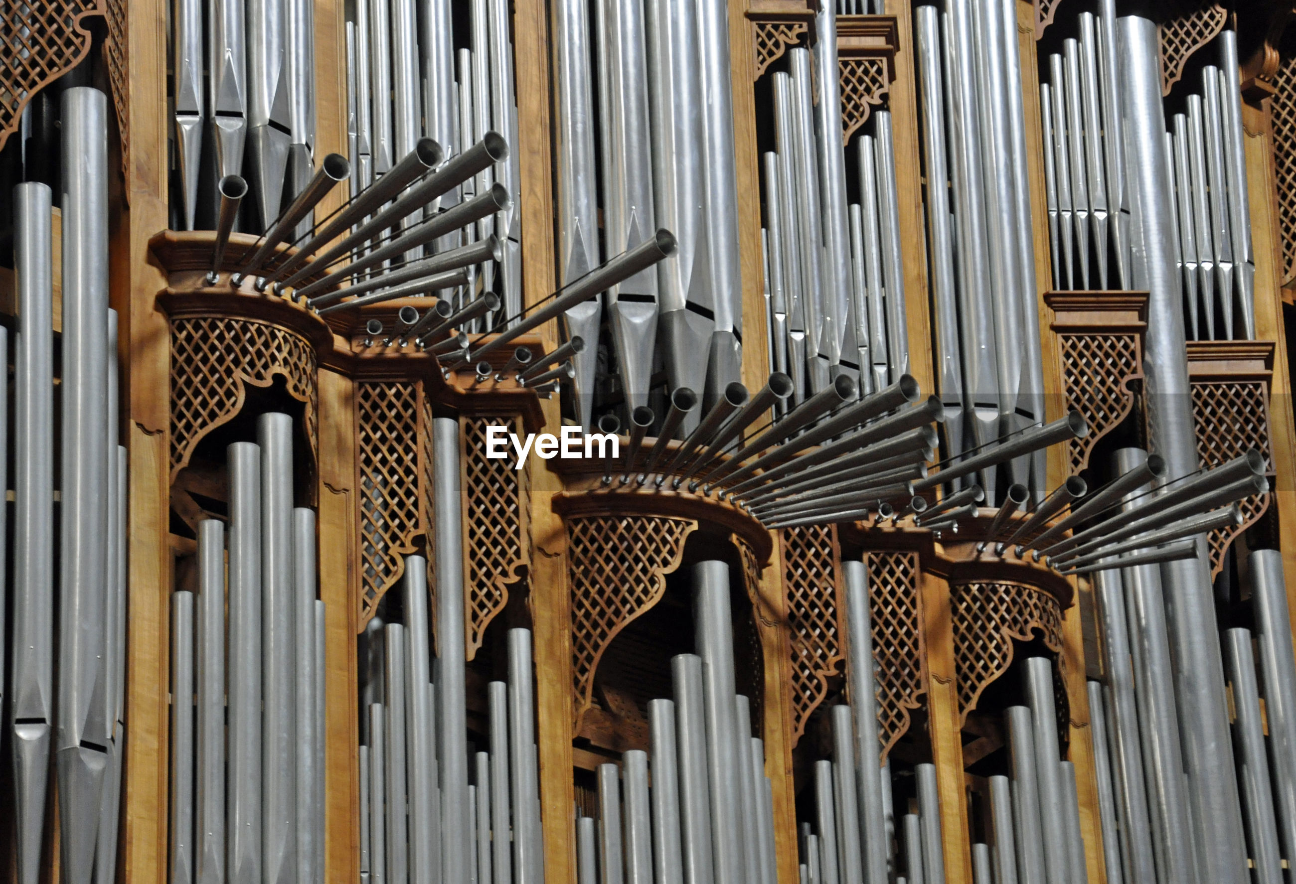 Low angle view of pipe organs in church