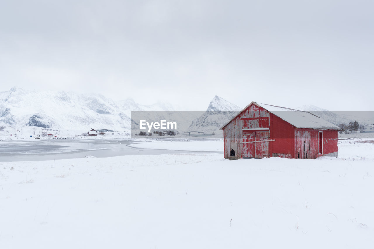 snow, winter, cold temperature, weather, house, nature, frozen, built structure, outdoors, scenics, white color, no people, building exterior, architecture, tranquility, tranquil scene, extreme weather, beauty in nature, mountain, landscape, day, snowing, snowdrift, sky