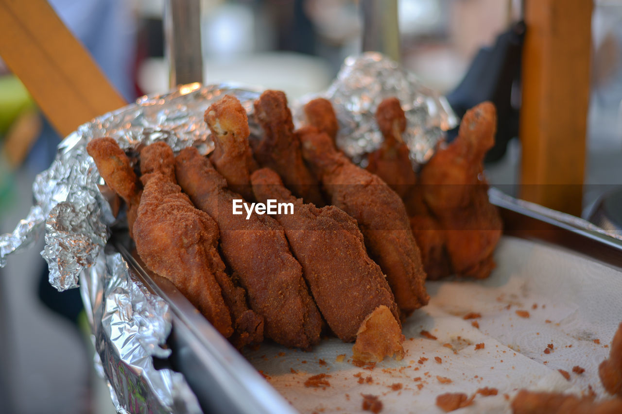 Close-up of chicken wings in tray for sale