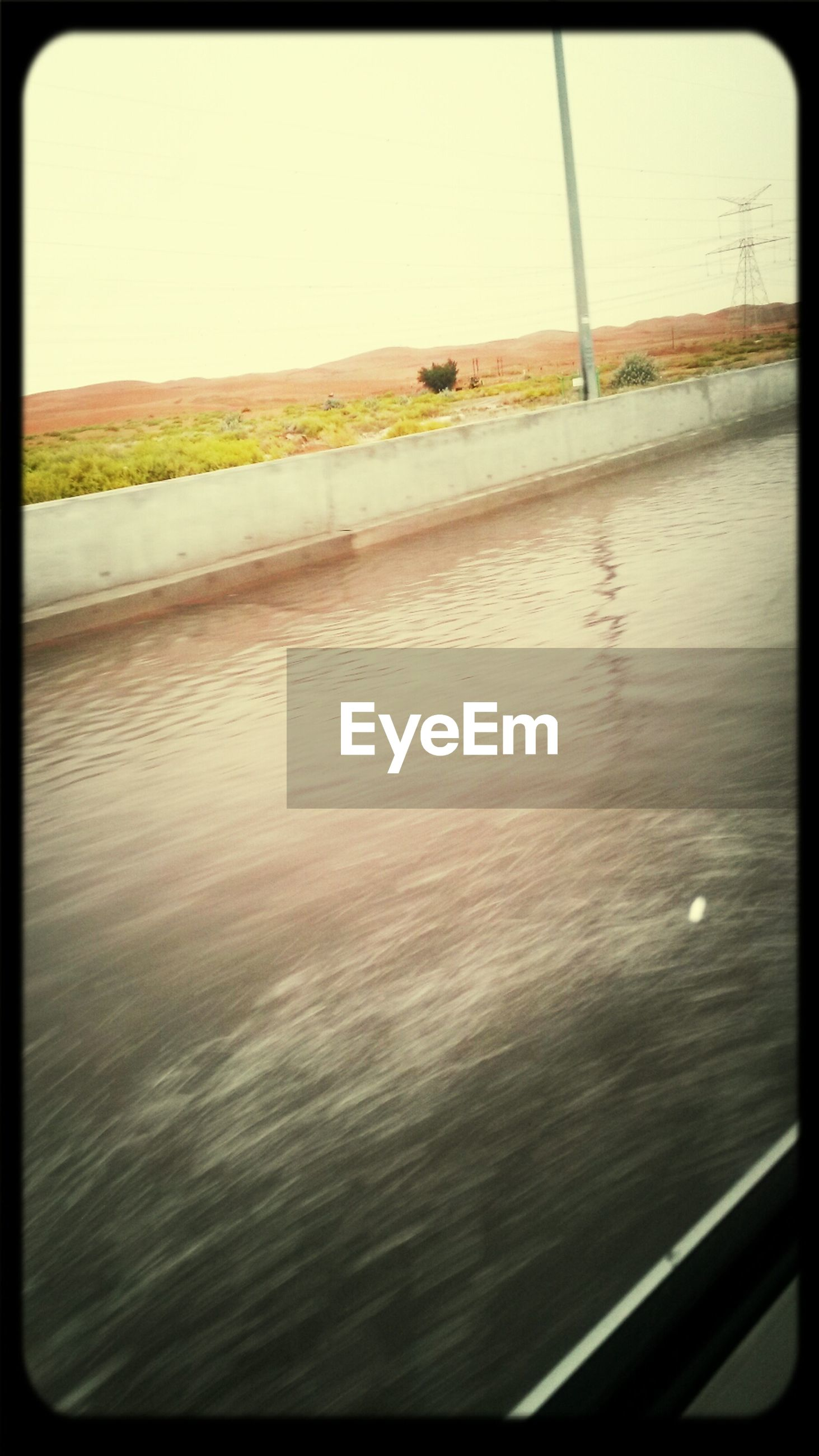 transfer print, auto post production filter, water, sea, clear sky, tranquil scene, tranquility, nature, scenics, beauty in nature, transportation, sky, horizon over water, lake, reflection, no people, outdoors, day, beach, rippled