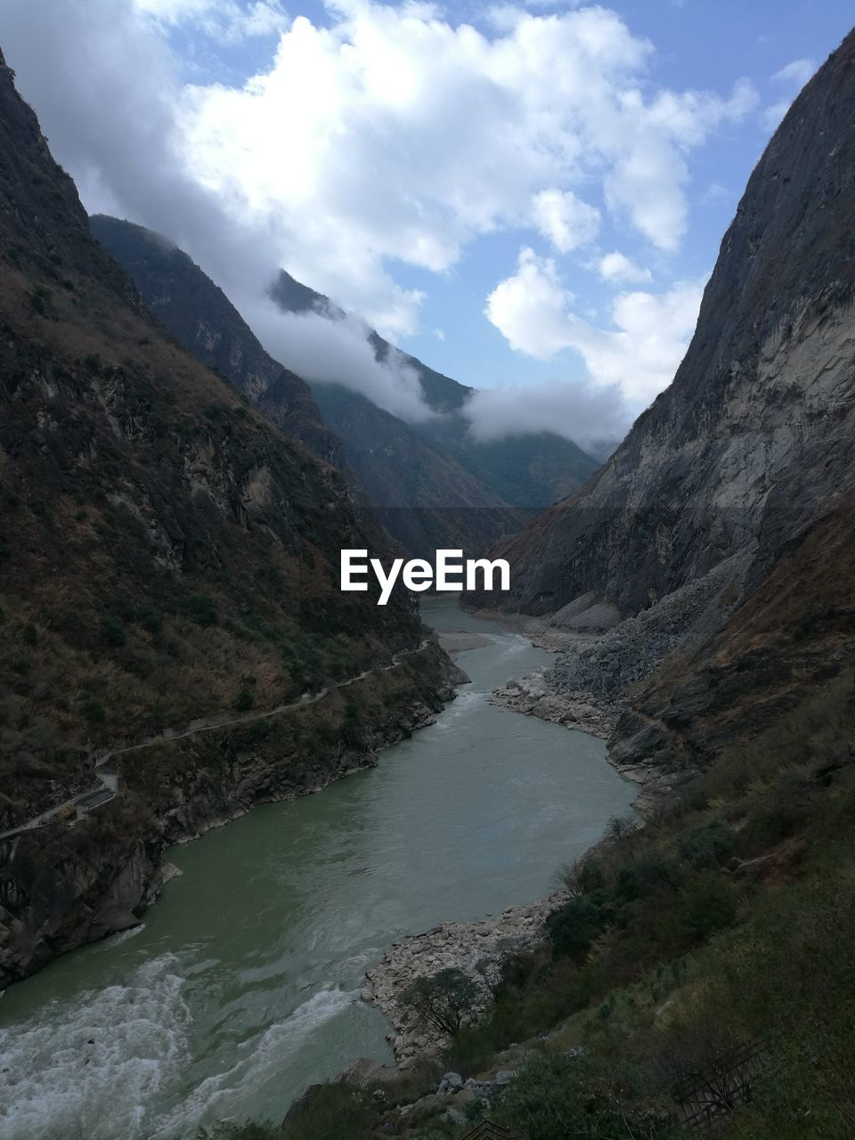 mountain, nature, beauty in nature, landscape, scenery, wilderness, environment, water, river, sky, day, outdoors, no people
