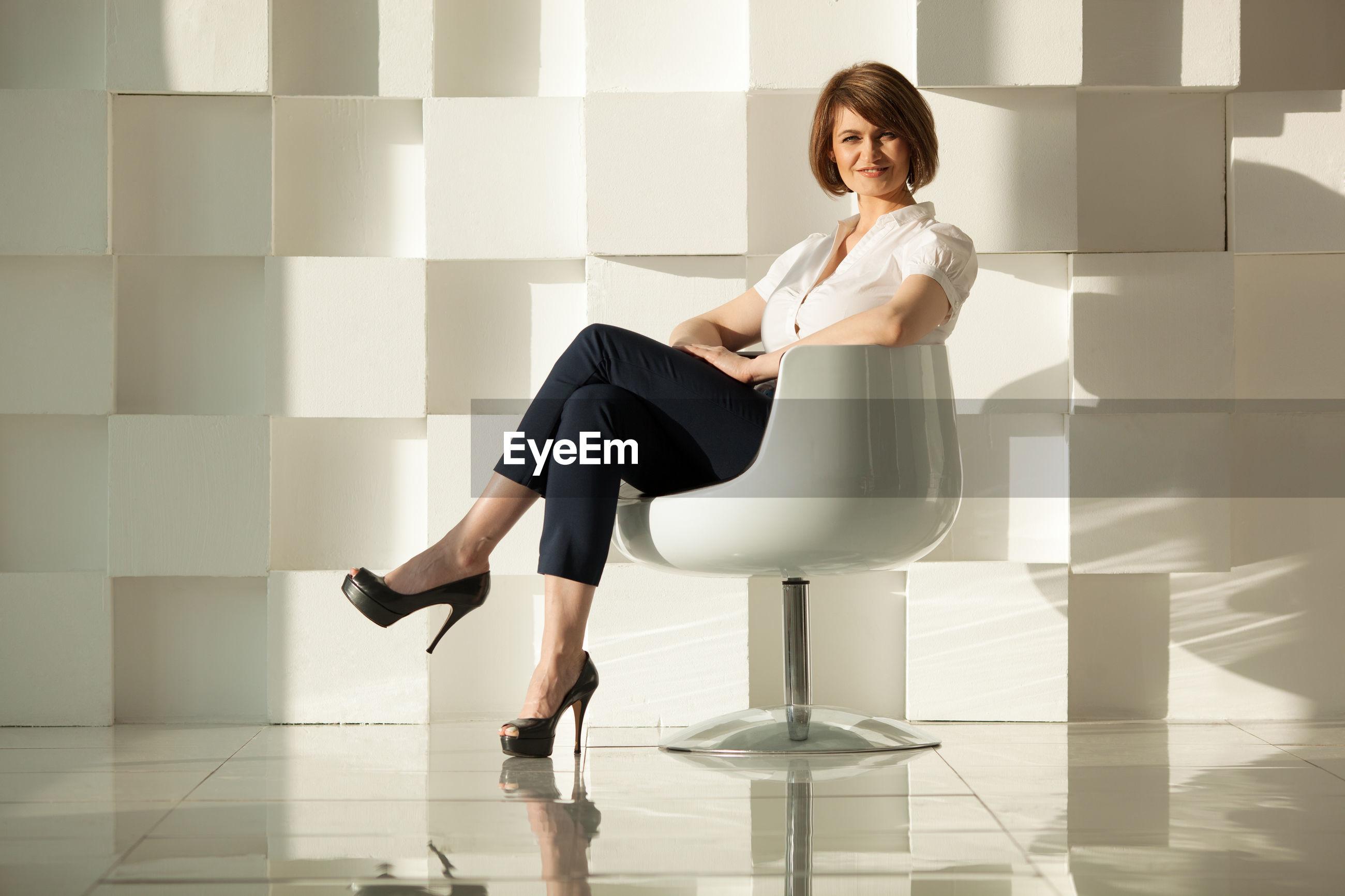 Portrait of confident businesswoman sitting on chair