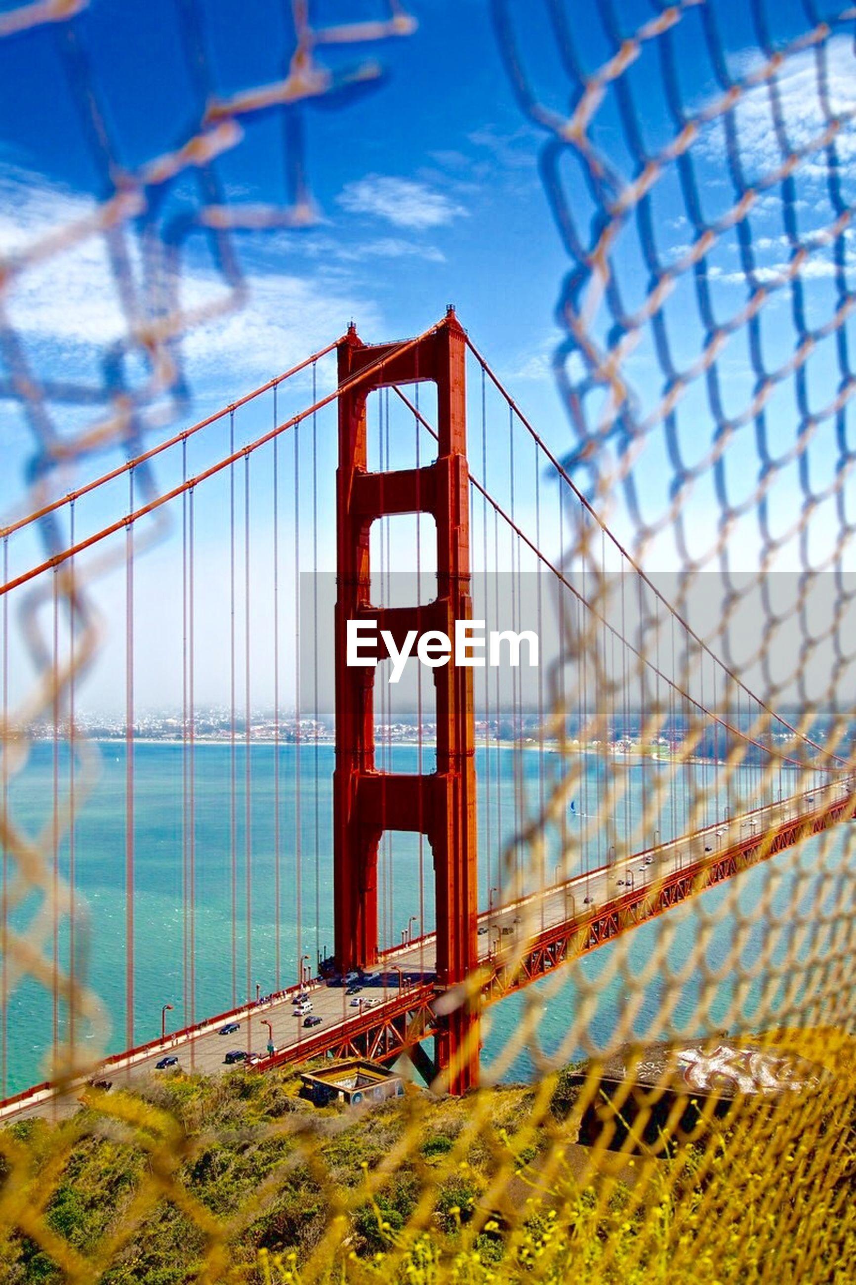 bridge - man made structure, suspension bridge, connection, architecture, engineering, sky, built structure, transportation, day, travel, travel destinations, bridge, no people, outdoors, nature