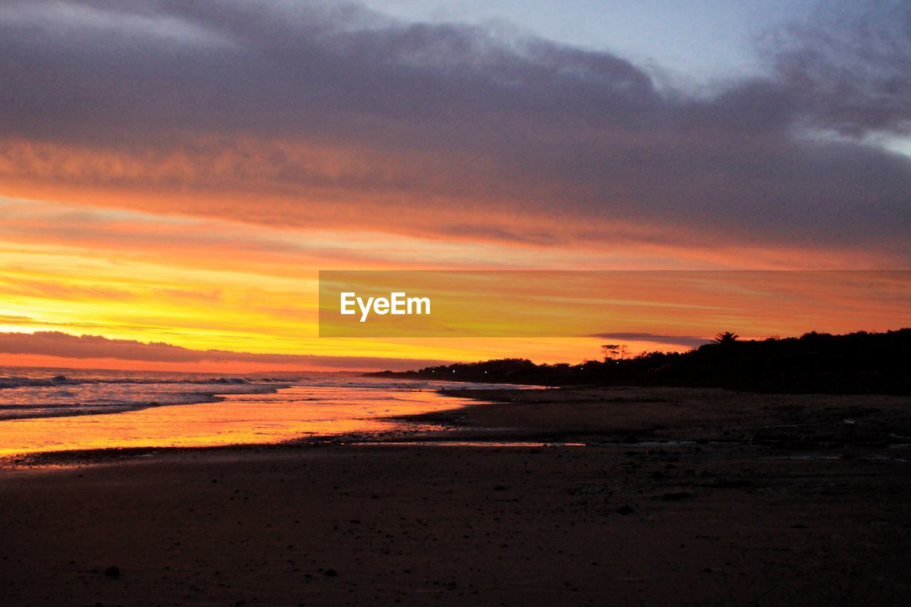 sunset, sky, beauty in nature, scenics - nature, cloud - sky, orange color, tranquility, tranquil scene, beach, land, water, sea, nature, idyllic, no people, silhouette, horizon, non-urban scene, dramatic sky, outdoors, horizon over water, romantic sky