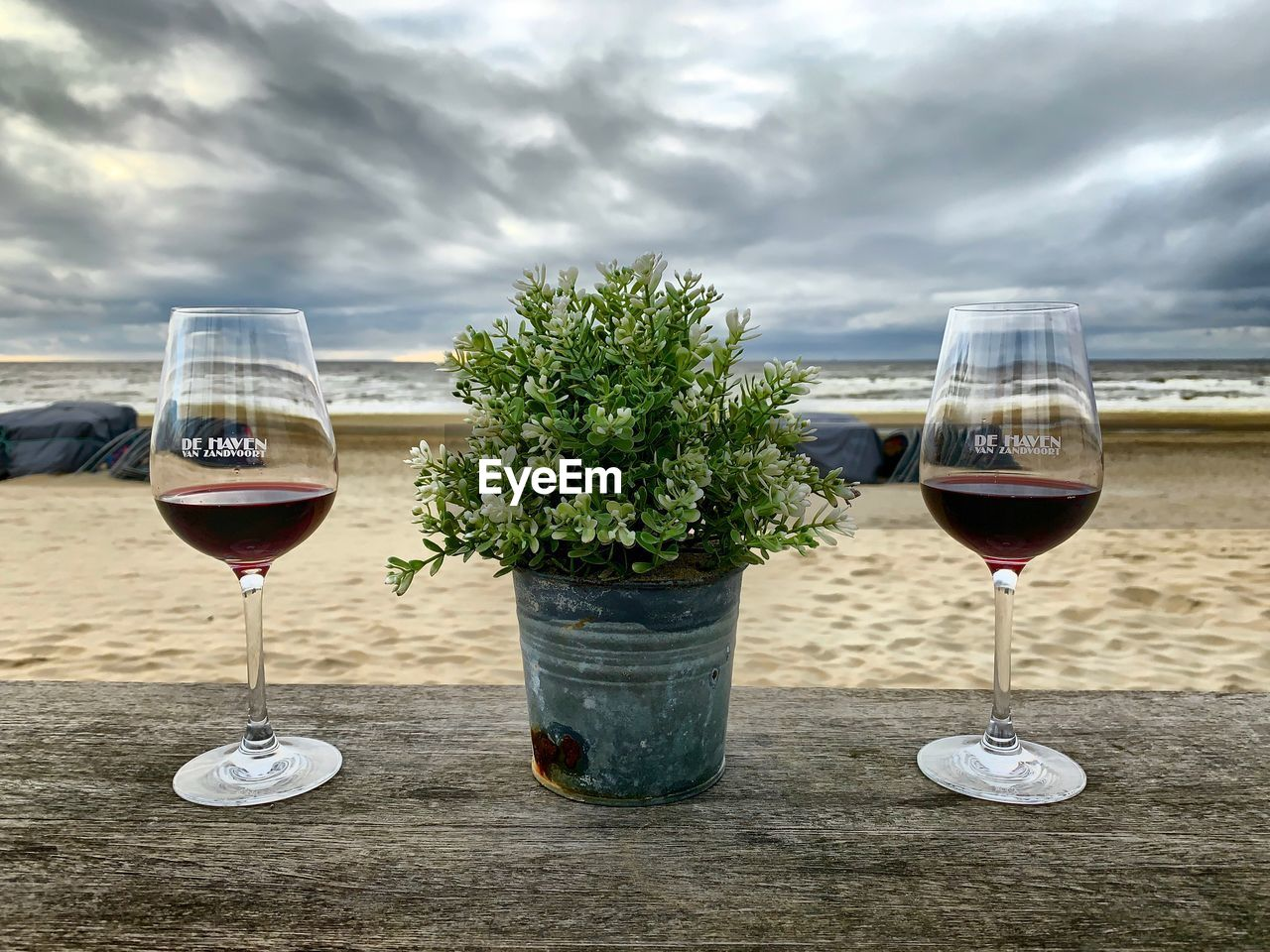 alcohol, refreshment, wine, drink, wineglass, glass, food and drink, freshness, transparent, sky, table, cloud - sky, glass - material, nature, red wine, no people, still life, day, close-up, food, outdoors