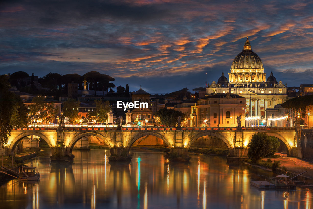 Ponte Sant Angel Over Tiber River In City At Night
