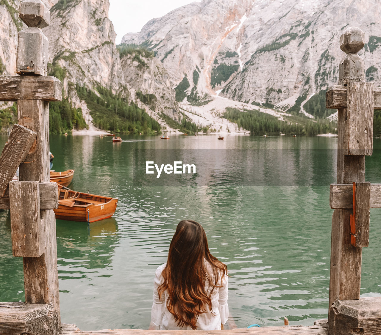 mountain, water, one person, women, lifestyles, real people, scenics - nature, mountain range, beauty in nature, leisure activity, day, rear view, lake, adult, nature, wood - material, tranquility, tranquil scene, outdoors, formation, hairstyle