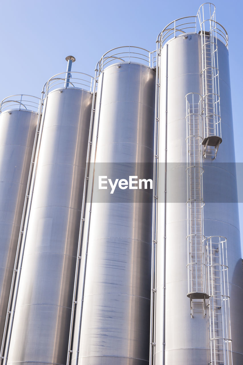 Low Angle View Of Silos Against Clear Sky