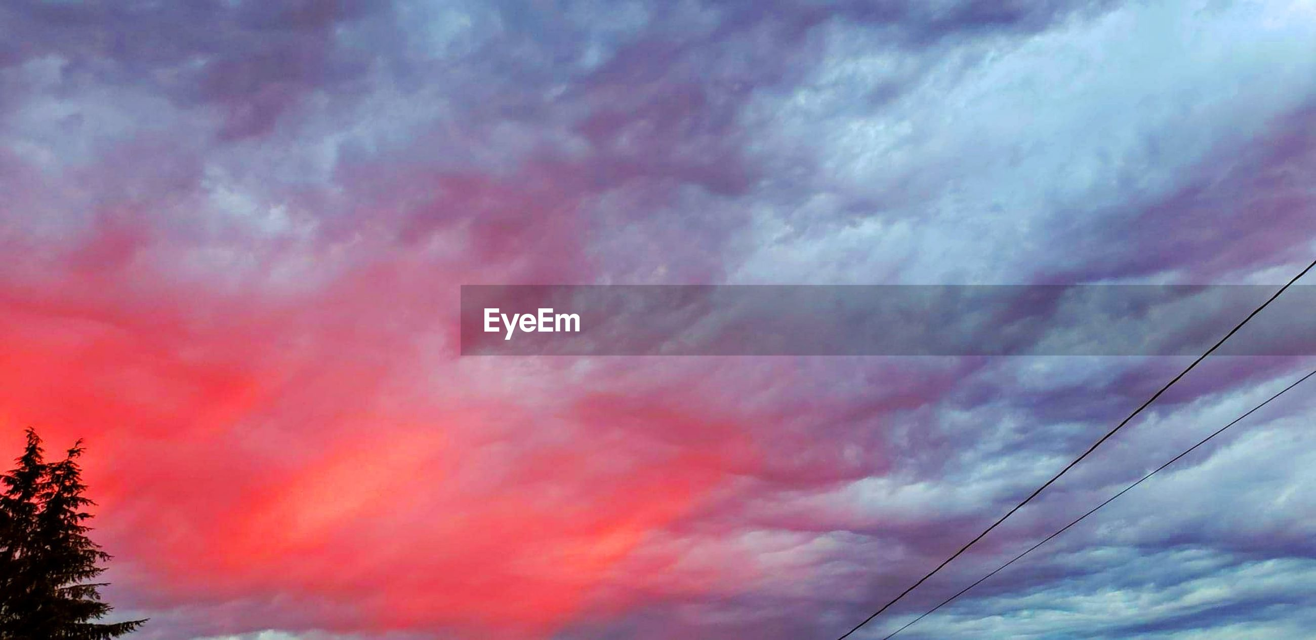 cloud - sky, sky, low angle view, beauty in nature, no people, nature, scenics - nature, tranquil scene, tranquility, dramatic sky, sunset, cable, outdoors, red, orange color, day, multi colored, tree, technology, meteorology, power supply