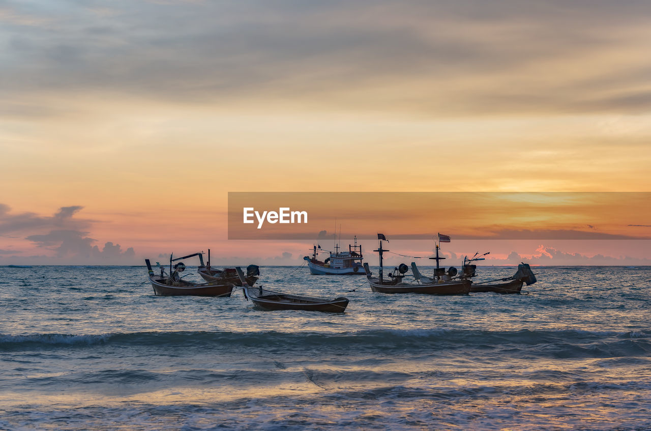 sunset, nautical vessel, sky, water, transportation, mode of transportation, sea, cloud - sky, scenics - nature, waterfront, beauty in nature, orange color, nature, motion, outdoors, men, idyllic, real people, travel