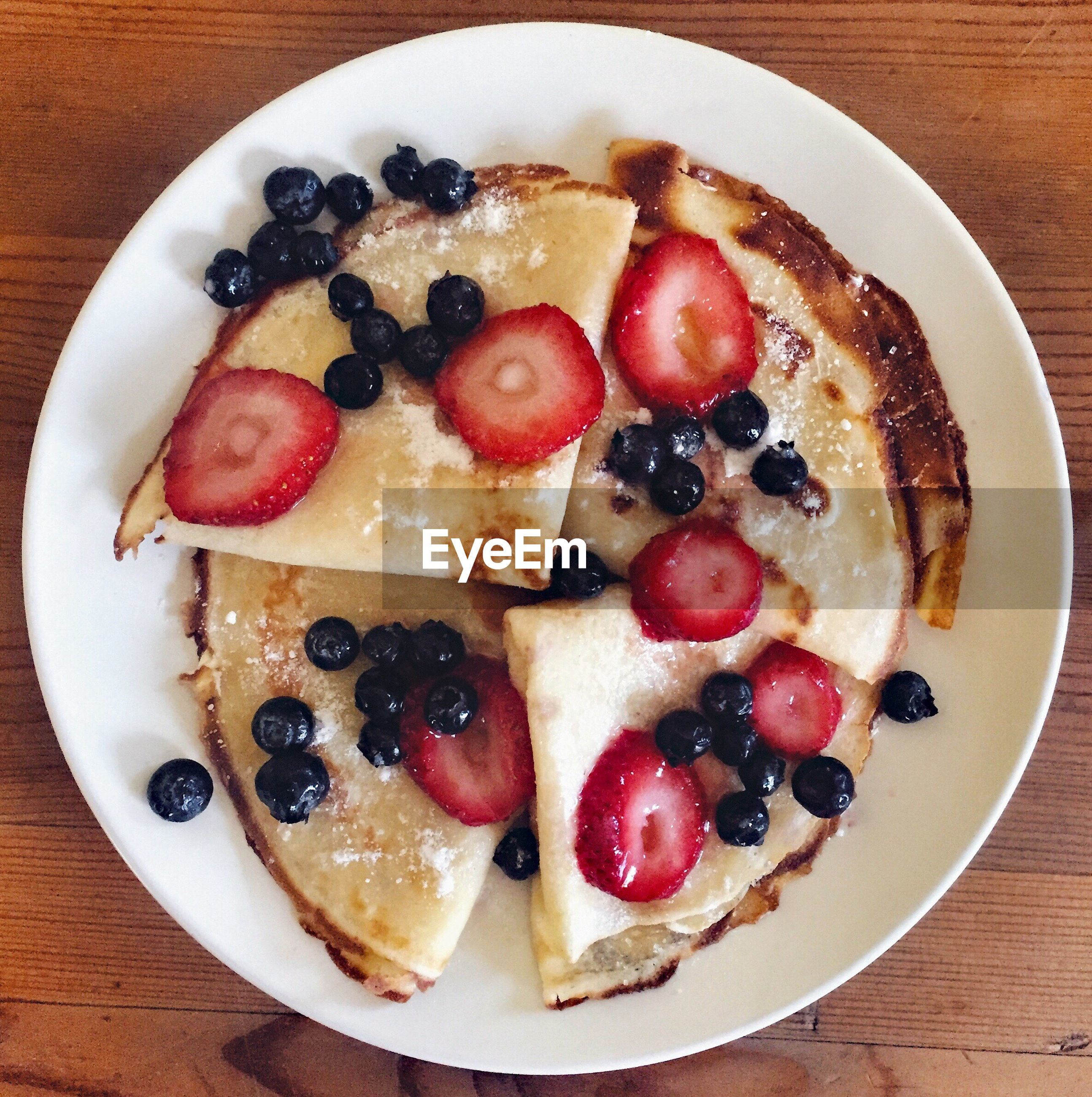 Directly above shot of pancakes served in plate on table