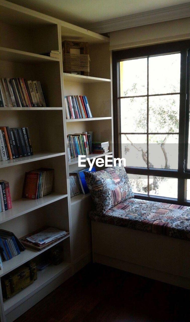 bookshelf, shelf, book, indoors, home interior, window, no people, day, library, domestic room
