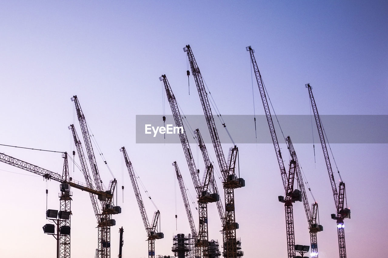 Low Angle View Of Silhouette Cranes Against Sky