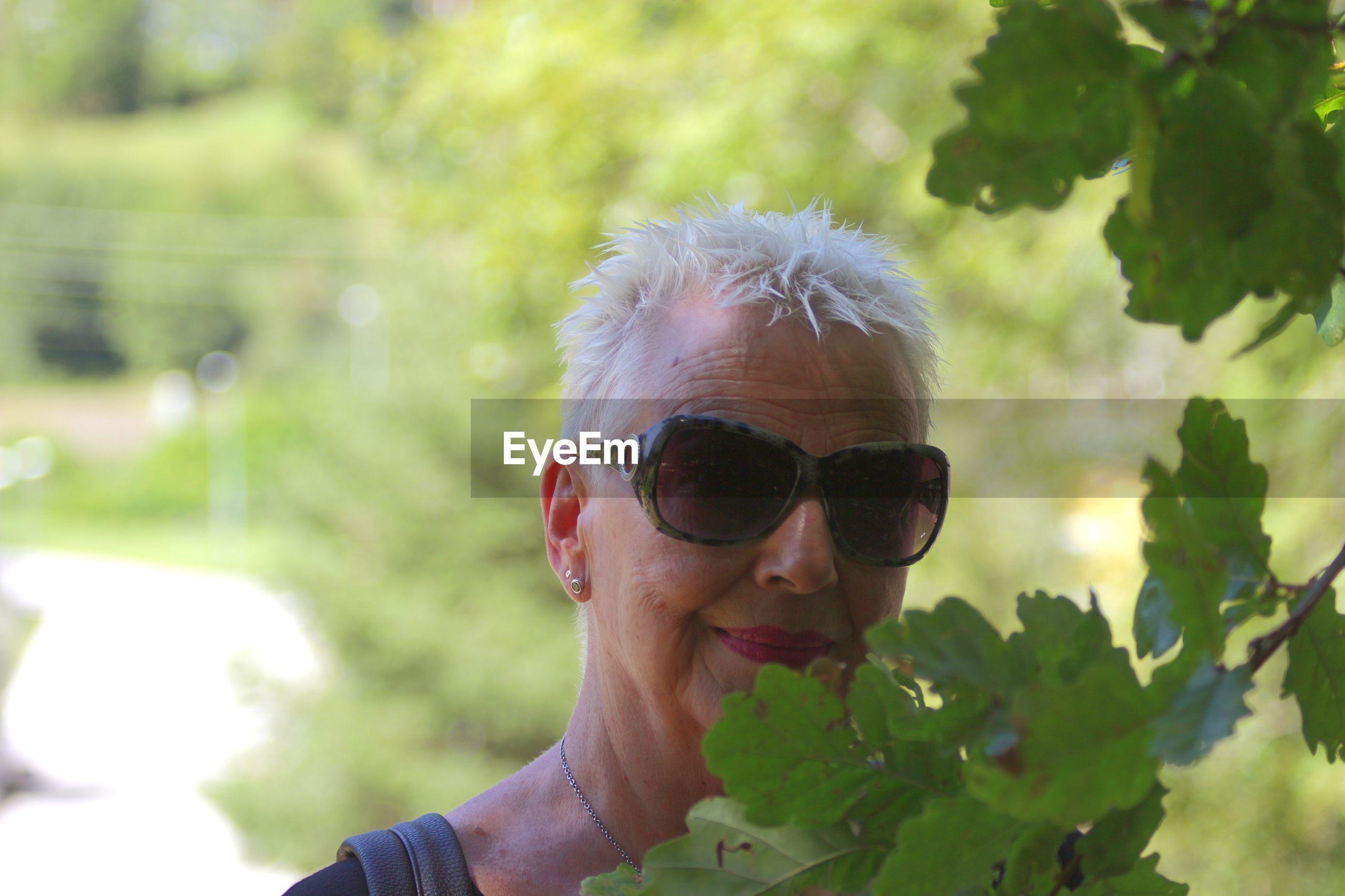 Portrait of grandmother wearing sunglasses