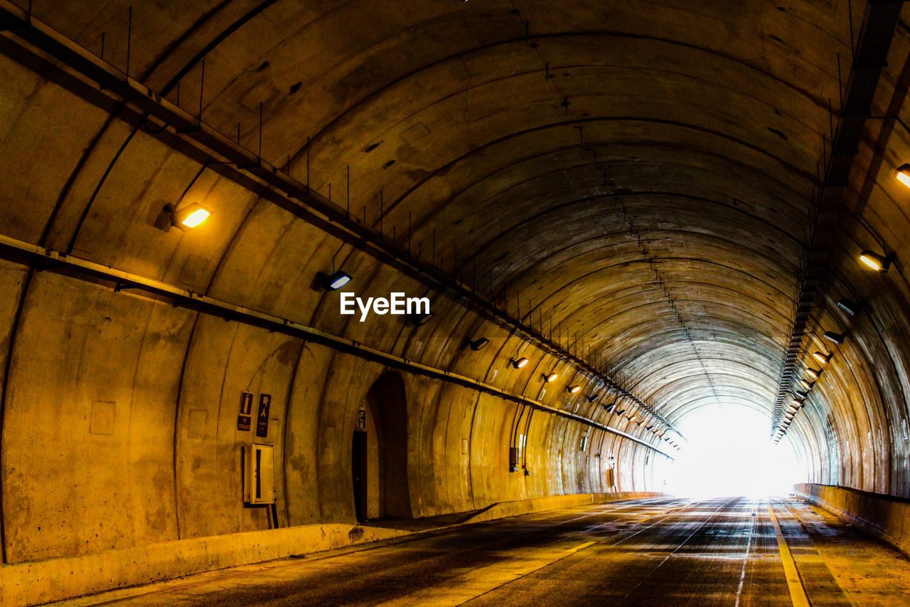the way forward, tunnel, illuminated, indoors, diminishing perspective, empty, arch, transportation, built structure, architecture, no people, road, day