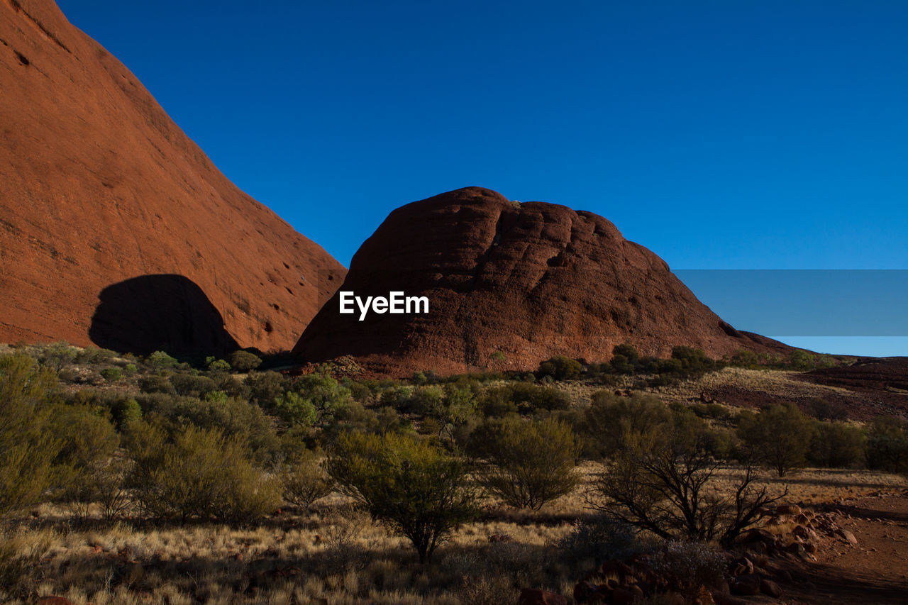 sky, scenics - nature, rock, rock formation, tranquil scene, environment, blue, beauty in nature, nature, tranquility, land, clear sky, landscape, rock - object, non-urban scene, mountain, no people, plant, remote, solid, outdoors, formation, arid climate, climate, eroded