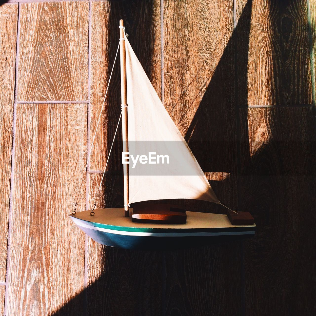 Sunlight Falling On Boat Figurine On Table