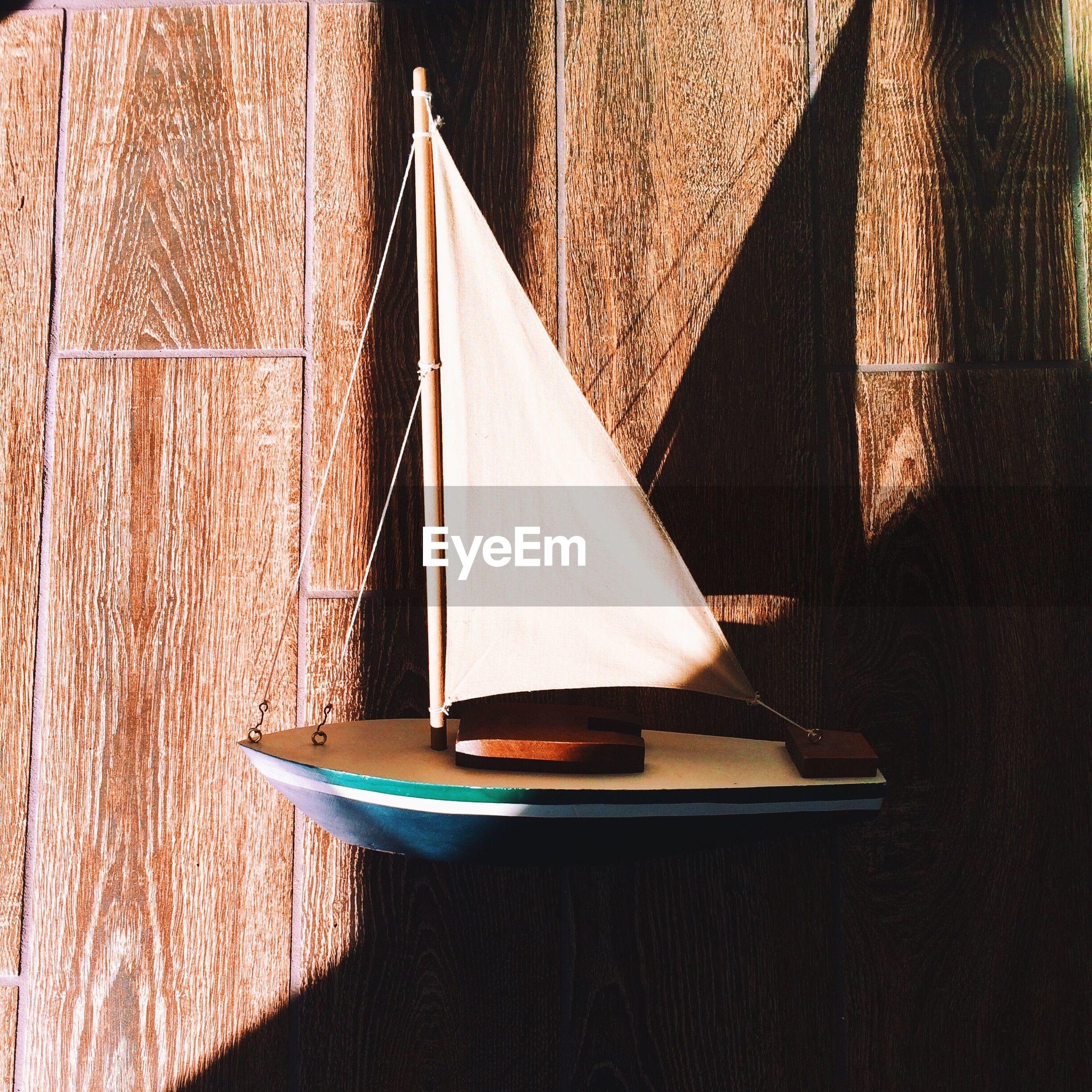 Sunlight falling on boat figurine on table