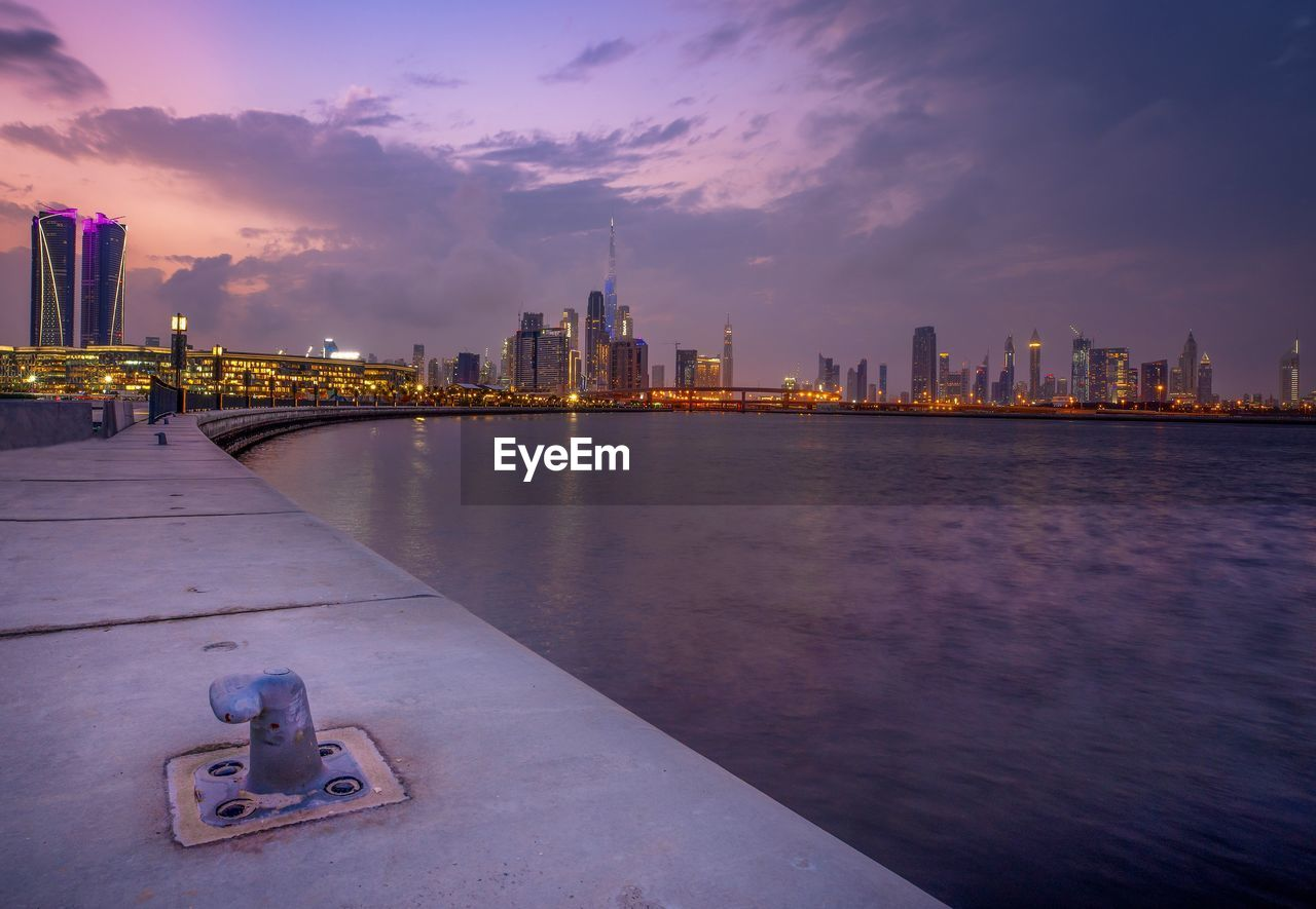 built structure, building exterior, sky, architecture, city, water, building, urban skyline, waterfront, cloud - sky, office building exterior, landscape, cityscape, river, nature, skyscraper, no people, tall - high, outdoors, modern, financial district, bay