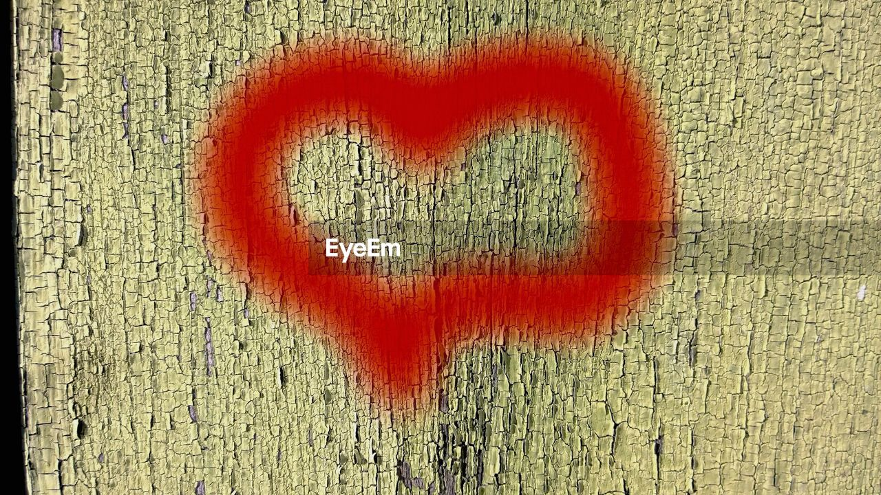 Close-Up Of Heart Shape On Wooden Wall