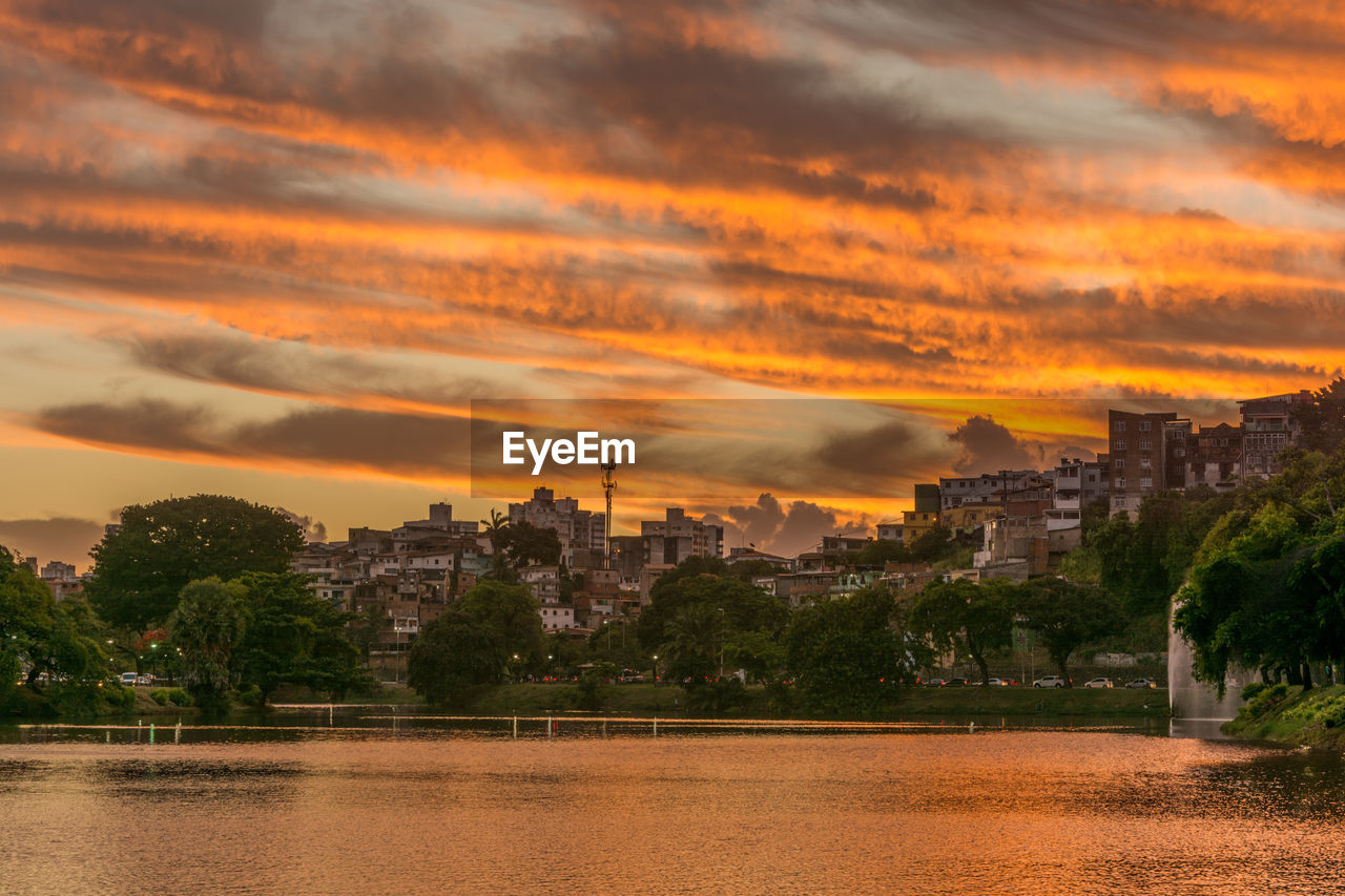 architecture, built structure, sunset, building exterior, cloud - sky, sky, orange color, travel destinations, history, water, ancient, spirituality, tourism, travel, no people, nature, outdoors, old ruin, tree, place of worship, city, beauty in nature, ancient civilization, cityscape, day