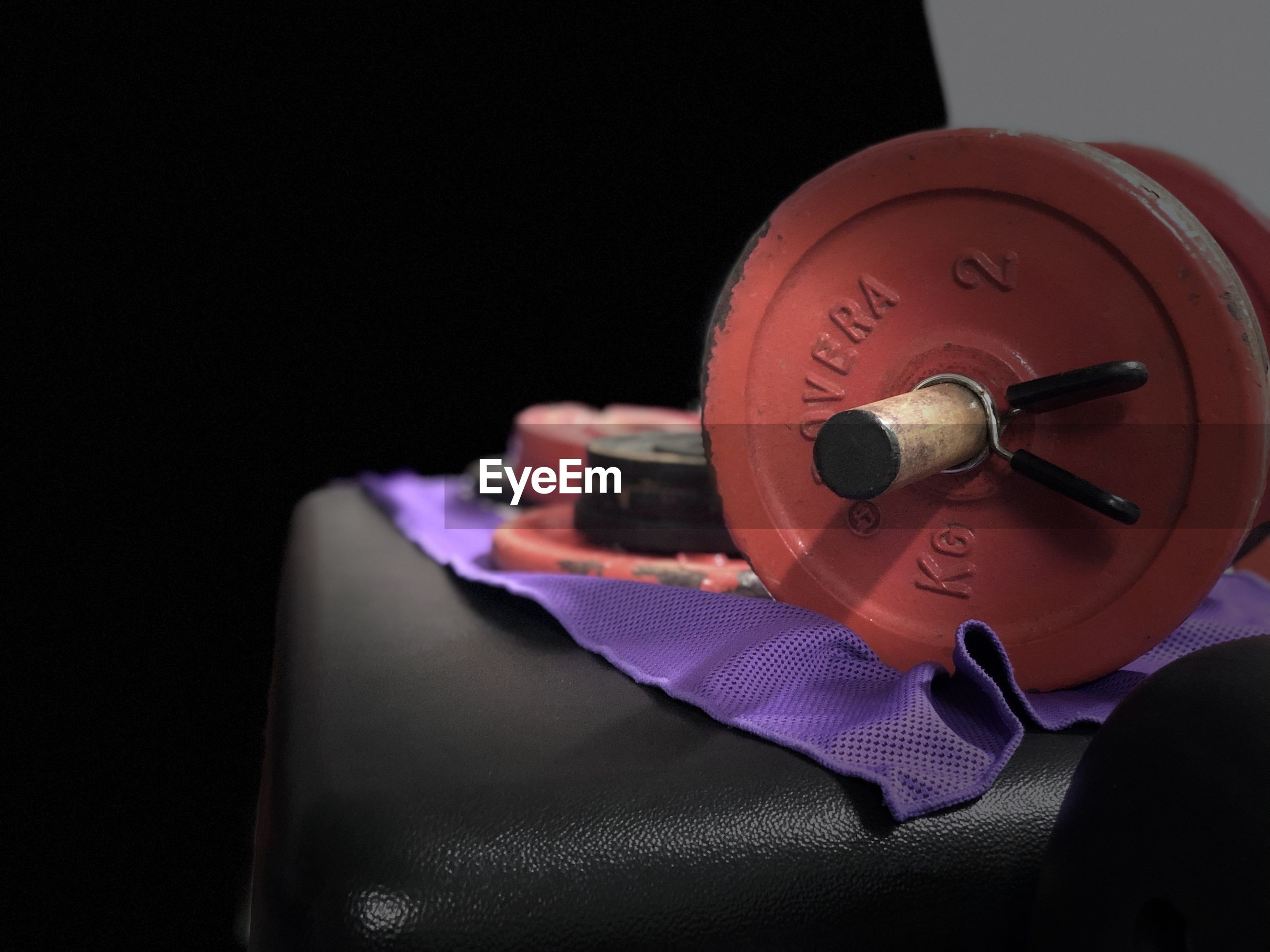 Close-up of gym weight over black background