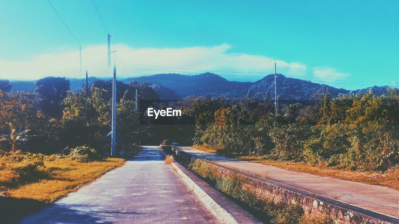 road, transportation, mountain, the way forward, nature, tree, beauty in nature, tranquil scene, scenics, landscape, day, outdoors, sky, tranquility, mountain range, no people, cable, forest, electricity pylon