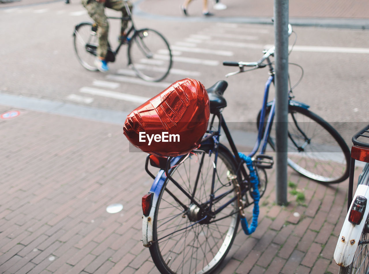 Bicycle On Street With Heart Shaped Balloon By Pole