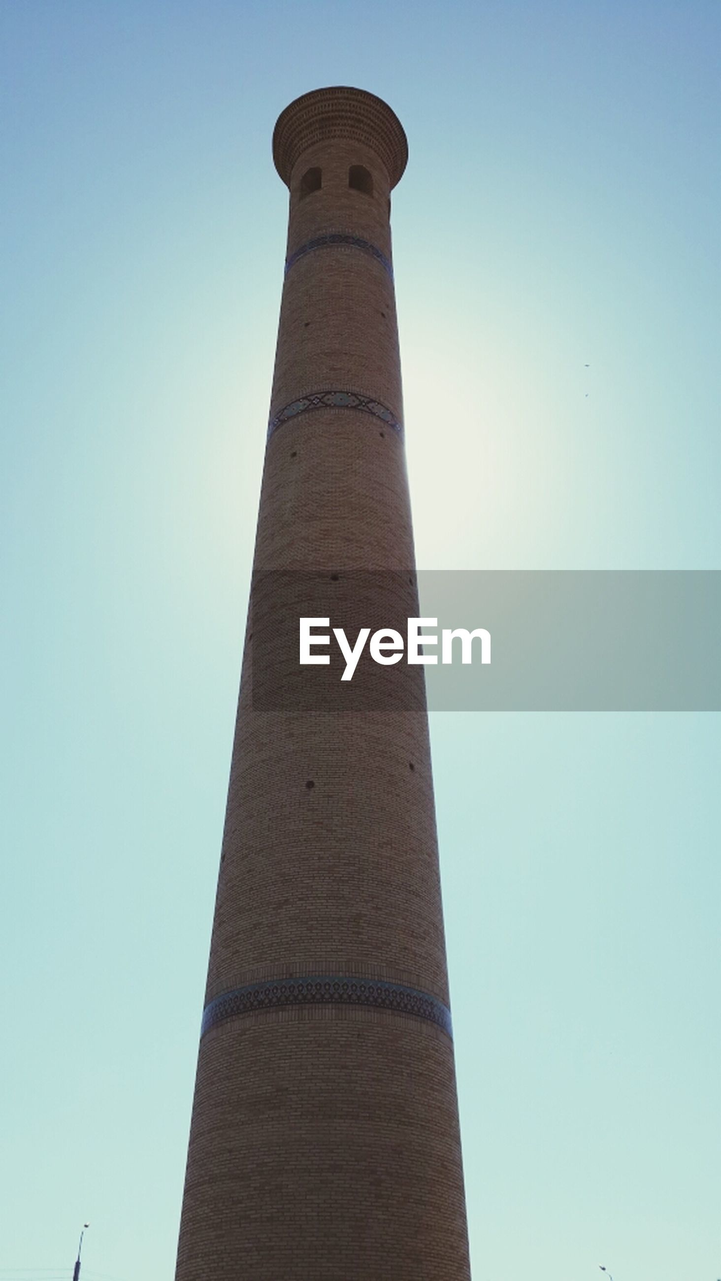 low angle view, architecture, built structure, clear sky, tower, tall - high, building exterior, blue, copy space, travel destinations, famous place, international landmark, tall, tourism, travel, history, no people, smoke stack, day, outdoors