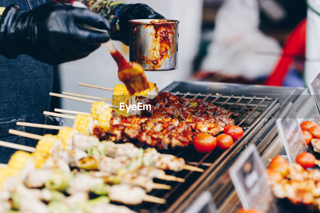 PEOPLE ON BARBECUE GRILL