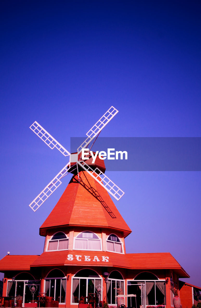 wind power, alternative energy, wind turbine, windmill, renewable energy, environmental conservation, traditional windmill, fuel and power generation, clear sky, blue, outdoors, day, no people, low angle view, industrial windmill, building exterior, built structure, architecture, technology, sky