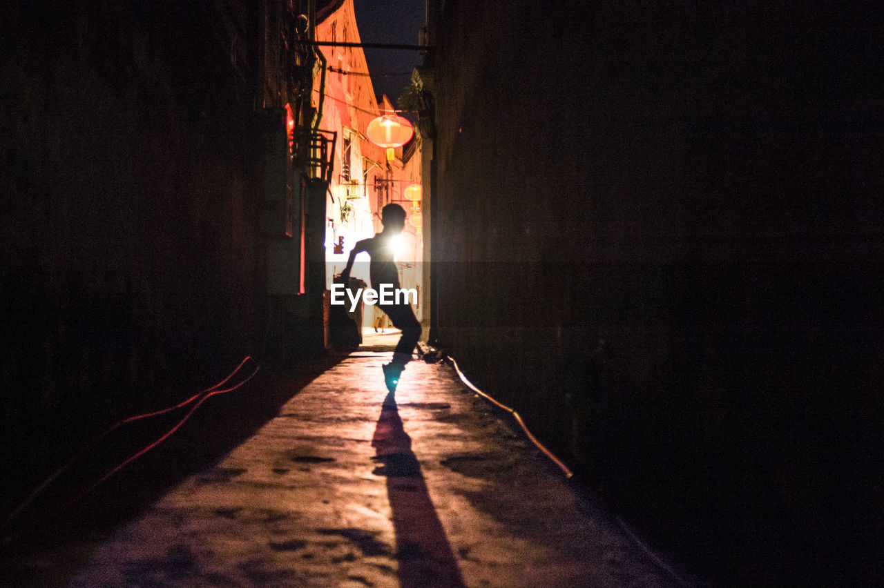Boy Dancing In Alley At Night