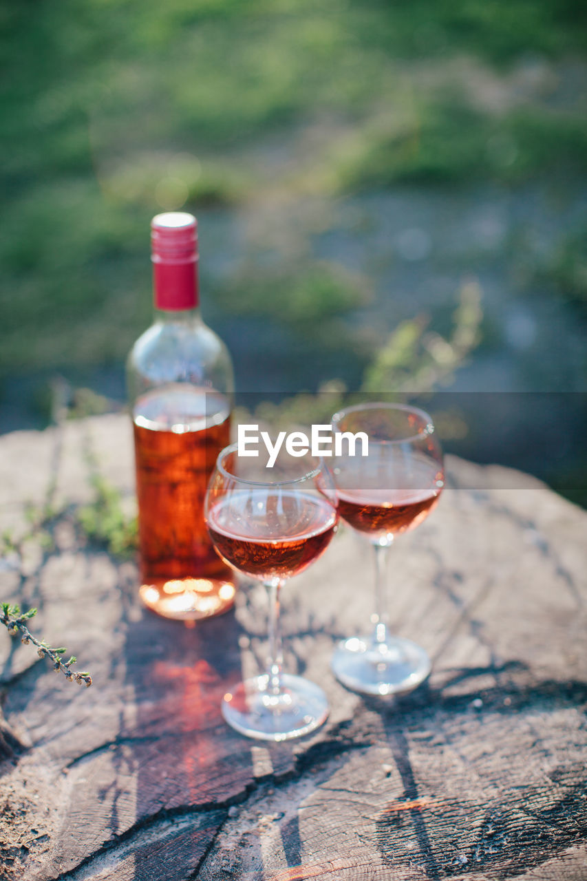 High angle view of red wine on rock