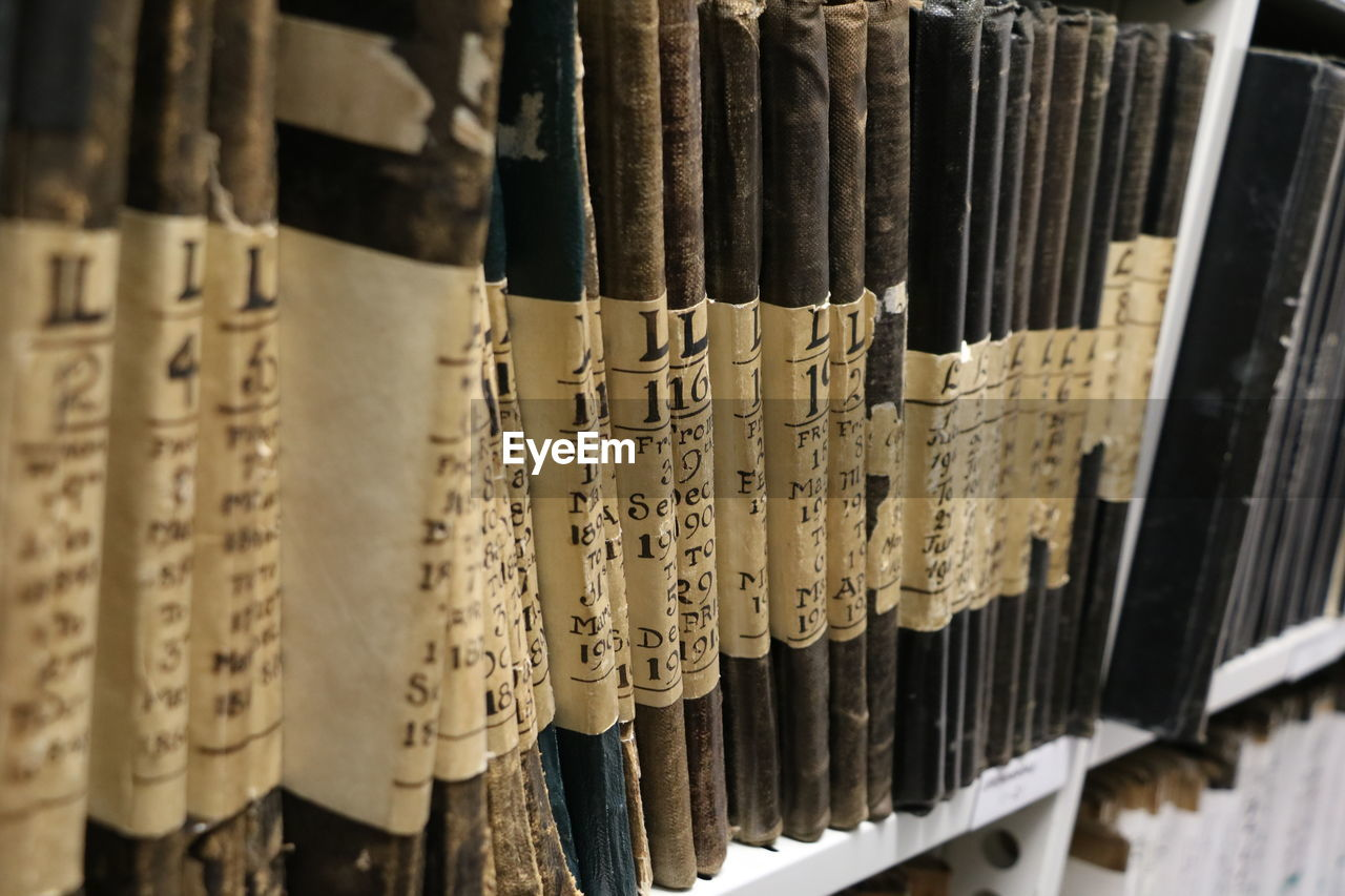 Close-up of files on shelf