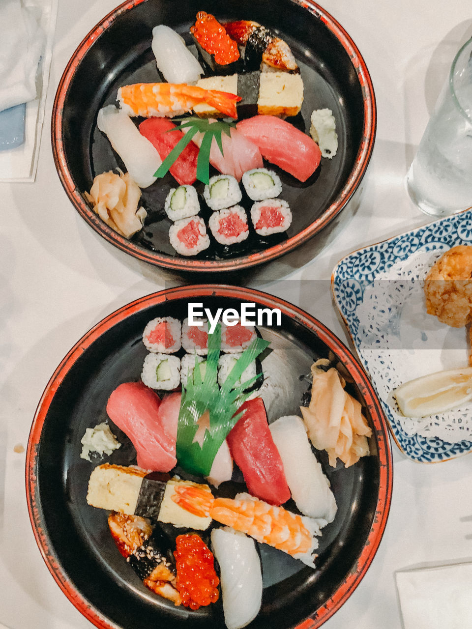 High angle view of sushi served in plates on table