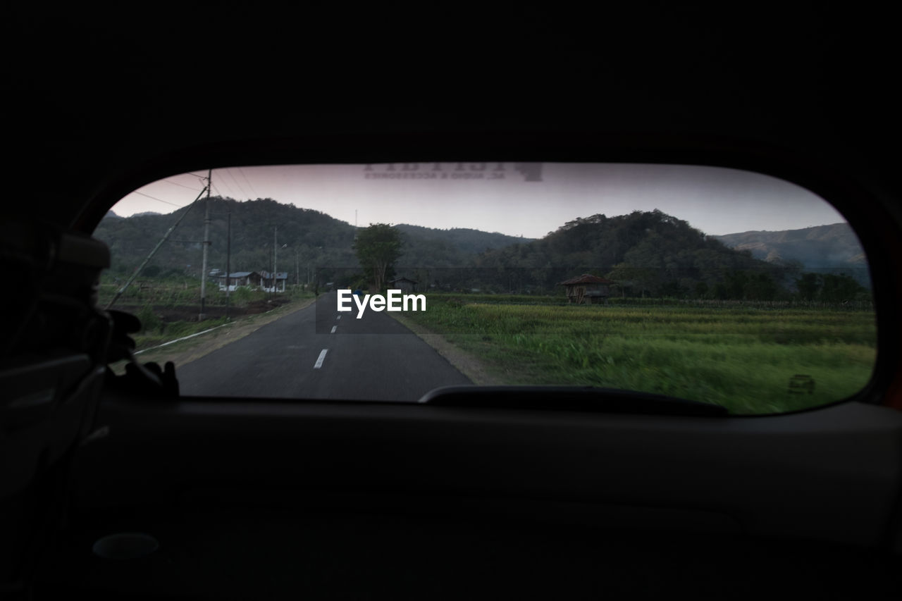 Road seen through rear windshield