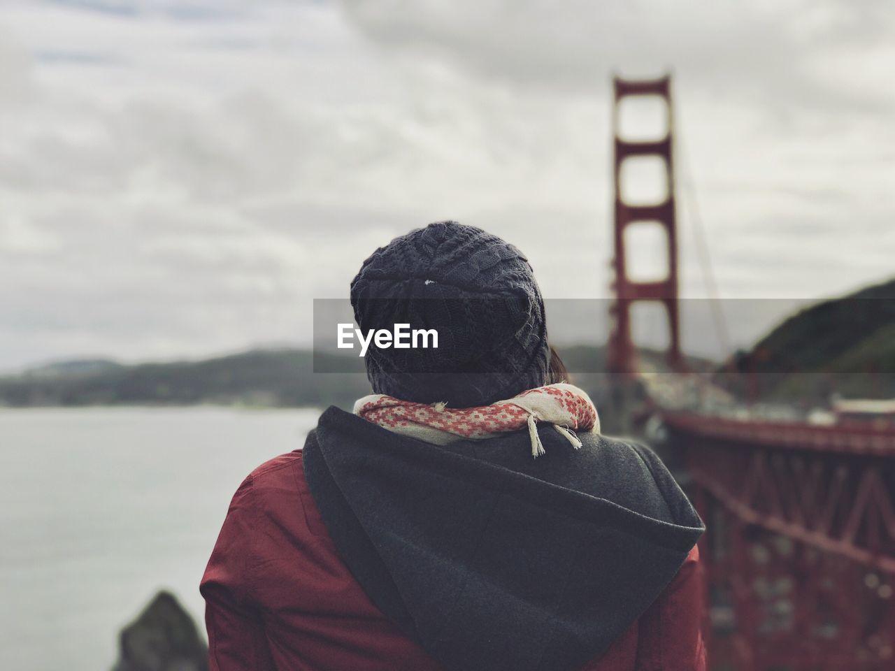 Rear View Of A Woman By Bridge