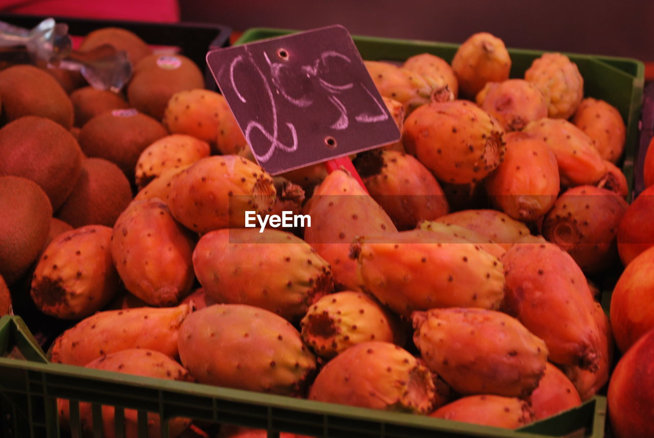 retail, for sale, price tag, market, large group of objects, food and drink, freshness, food, abundance, market stall, no people, text, close-up, healthy eating, heap, fruit, choice, day, indoors
