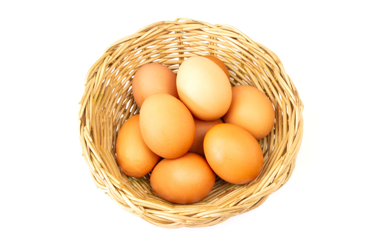 egg, food, food and drink, freshness, white background, studio shot, container, healthy eating, cut out, wellbeing, basket, wicker, indoors, brown, still life, raw food, no people, animal egg, high angle view, close-up