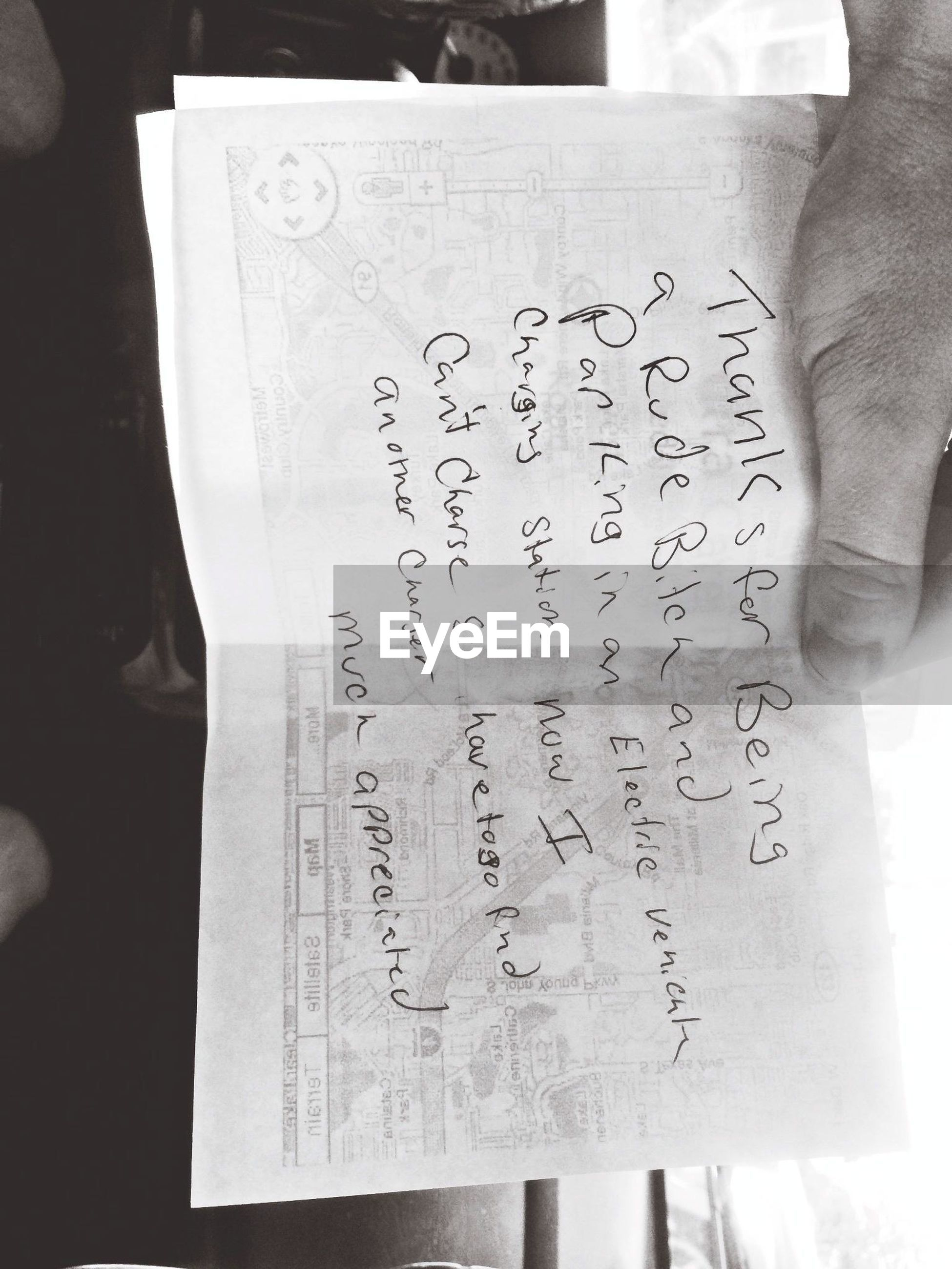 text, western script, indoors, communication, close-up, paper, person, non-western script, part of, book, cropped, focus on foreground, art and craft, message, creativity, art, handwriting