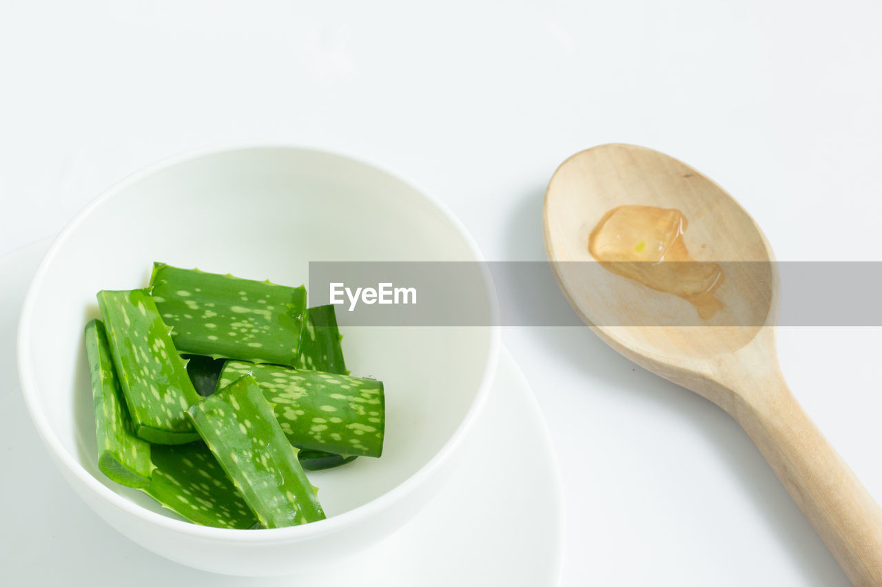 Aloe Vera Gel With Wooden Spoon On White Background